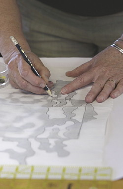 drawing over design onto tracing paper in a Notan workshop. Dorothy Russell